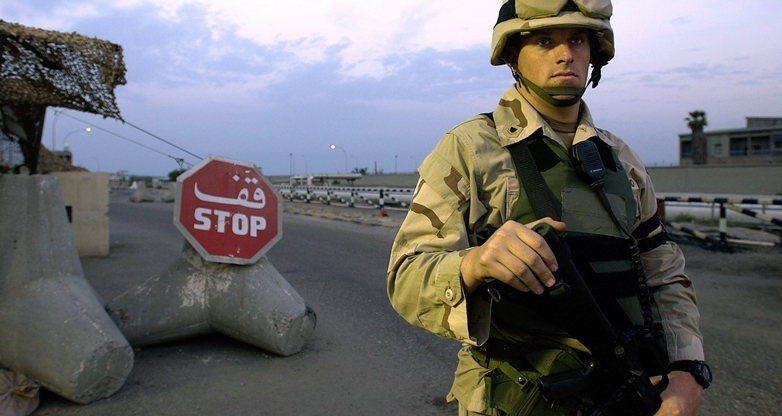ASH SHUAIBA, Kuwait (March 26, 2004)-Port Security Specialist 2nd Class Steven Gruber, 28, from Ft. Myers, of Coast Guard Port Security Unit (PSU) 307 from St. Petersburg, Fla., stands watch at a checkpoint.