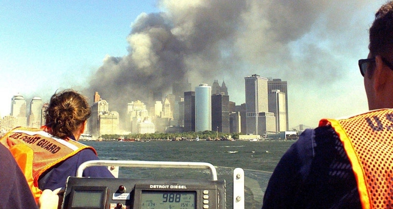 Members on patrol in New york harbor look towards the smoke of the Twin Towers destroyed during the terrorist attacks of September 11, 2001