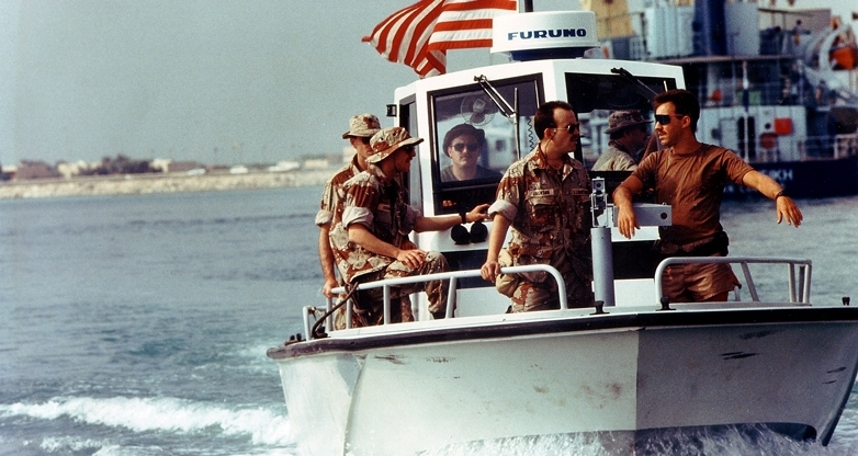 Members of U.S. Coast Guard Port Security Unit 302 patrol the harbor aboard a Navy harbor patrol boat during Operation Desert Shield