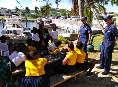 Reservist talk to at-risk youth from Project Promise about career opportunities in the Coast Guard