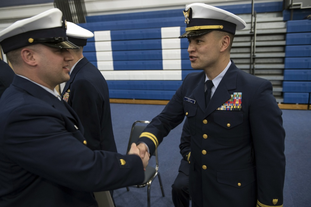 LT Graff shakes the hand of a graduate during the graduation ceremony